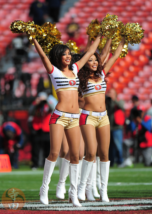 August 20, 2011; San Francisco, CA, USA; San Francisco 49ers Gold Rush cheerleaders Aleena (left) and Carmen (right) perform before the game against the Oakland Raiders at Candlestick Park. The 49ers defeated the Raiders 17-3. Mandatory Credit: Kyle Terada-Terada Photo