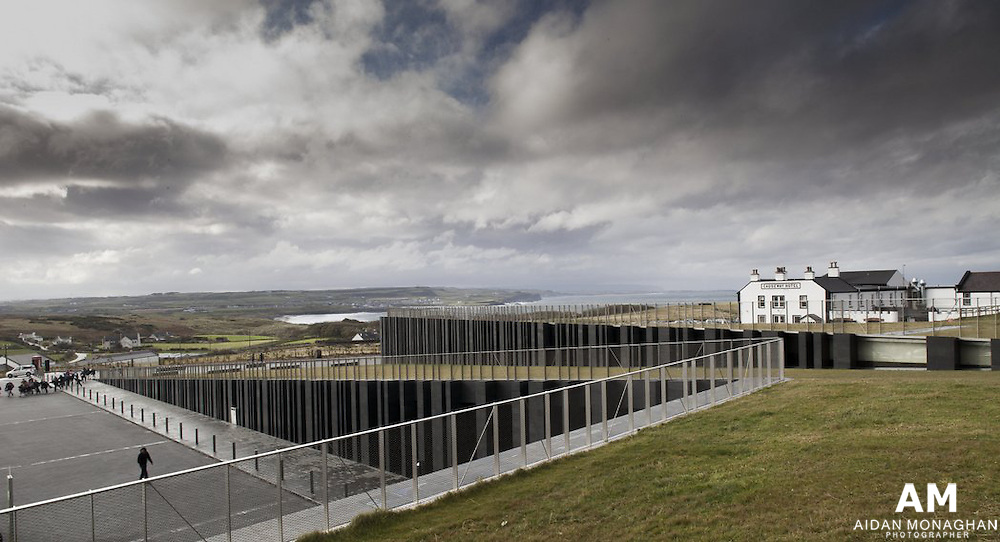 Giant's Causeway Visitors' Centre<br /> Antrim, Northern Ireland<br /> Heneghan Peng architects<br /> The Giant's Causeway lies in Northern Ireland's Causeway Coast World Heritage Site, a landscape of cliffs formed by hexagonal basalt stones, agricultural landscapes and cliffside walks. Utilising the large difference in level across the site, two folds are created in the landscape. One, extending the line of the ridge, accommodates the building. The second, extending the level of the road, screens the car park from view.<br /> Client<br /> National Trust<br /> Size<br /> 1800m²<br /> Date<br /> 2005 (Competition)<br /> Status<br /> Construction<br /> Location<br /> Antrim, Northern Ireland