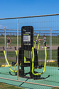Park gym equipment closed off at Christison Park, Vaucluse, Sydney. They are seen cged off to the public.