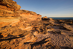 Early morning light strikes the sandstone at Riddell Beach near Broome Port.