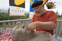 Artist Harreson Tanner demonstrates sculpture at Yukon Artists @ Work studio