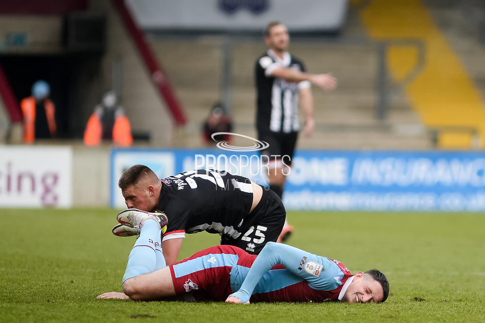 Scunthorpe United Ryan Loft (9) suffers injury during the EFL Sky Bet League 2 match between Scunthorpe United and Grimsby Town FC at the Sands Venue Stadium, Scunthorpe, England on 23 January 2021.