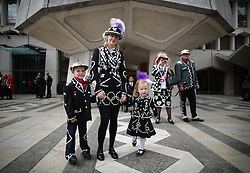 © Licensed to London News Pictures. 27/09/2015. London, UK. The Pearly Prince and two Princesses of Woolwich pose for photographs in Guildhall Square during a Harvest Festival celebration. Photo credit: Peter Macdiarmid/LNP