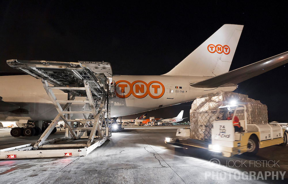 A TNT Express Worldwide S.A. Boeing 747 cargo plane is unloaded, serviced, and reloaded, at the Liège Airport in Grâce-Hollogne, Belgium, on Friday July 23, 2010. Approximately  90,000 packages move through TNT's main European hub every night. (Photo © Jock Fistick)
