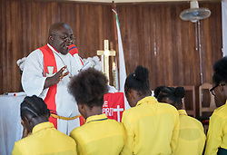 3 November 2019, Monrovia, Liberia: Rev. Jesse King gathers children around the altar to bless them after Sunday service at Saint Andrew Lutheran Parish in Monrovia. Part of the Lutheran Church in Liberia, the parish gathers some 220 members for prayer each week.