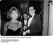 Mr. & Mrs. Roger Moore. L'Orangerie Party. Los Angeles. March 1990<br /><br />© Copyright Photograph by Dafydd Jones<br />66 Stockwell Park Rd. London SW9 0DA<br />Tel 0171 733 0108<br />Film 90207