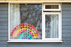 ©Licensed to London News Pictures 26/03/2020  <br /> Orpington, UK. A large rainbow made of hearts in a window in Orpington, South East London. Children are putting up colourful rainbow artwork on their homes to show gratitude and support for NHS workers. credit:Grant Falvey/LNP