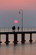 People enjoying summer evening at Sunset on Bayside pier.<br /> <br /> Larger JPEGs and TIFF file available  Contact EFFECTIVE WORKING IMAGE.via our contact page at : www.photography4business.com.