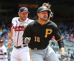 May 25, 2017 - Atlanta, GA, USA - Pittsburgh Pirates' Jordy Mercer is safe at first when Atlanta Braves' Matt Adams loses the handle on the ball during the second inning in a MLB baseball game on Thursday, May 25, 2017, in Atlanta. The Pirates scored five runs in the second inning to take a 5-0 lead. (Credit Image: © Curtis Compton/TNS via ZUMA Wire)