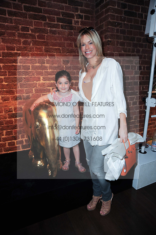 CAROLINE HABIB and her daughter YASMIN HABIB at a private view of Sacha Jafri's paintings entitled 'London to India' held in aid of The Elephant Family charity at 23 Macklin Street, Covent Garden, London on 3rd June 2010.