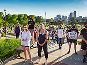 01 JUNE 2020 - DES MOINES, IOWA: People on the lawn below the Iowa State Capitol with the Des Moines skyline in the background. About 1,000 people gathered in front of the Iowa State Capitol in Des Moines Monday evening for a rally calling for racial justice. The rally was one week after George Floyd, an unarmed black man, was killed by a Minneapolis police officer who knelt on Floyd's back for more than eight minutes. There were protests  in Des Moines all weekend against Floyd's killing. There was some violence and some people have been arrested but the protests in Des Moines haven't been as serious as protests in other cities.          PHOTO BY JACK KURTZ
