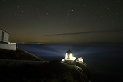 St Abbs Lighthouse near Eyemouth on the Scottish Borders last night as the Northern Lights appear on the horizon.