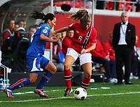 Fotball , EM , Norge - Island 11.juli 2013 , kvinner ,  Sverige , Kalmar<br /> Maren Mjelde , Norge<br /> Holmfridur Magnusdottir , Island<br /> <br /> Foto: Ole Marius Fjalsett
