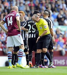 Referee, Mike Dean moves the Newcastle Wall - Photo mandatory by-line: Joe Meredith/JMP - Mobile: 07966 386802 23/08/2014 - SPORT - FOOTBALL - Birmingham - Villa Park - Aston Villa v Newcastle United - Barclays Premier League