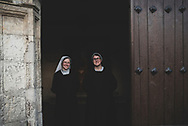 Sister Clara, from the Czech Republic, and Sister Mercedes, from Spain, stand in the doorway at the end of an evening service at the Monasterio de las Benedictas in Leon, Spain. (June 24, 2018)<br />