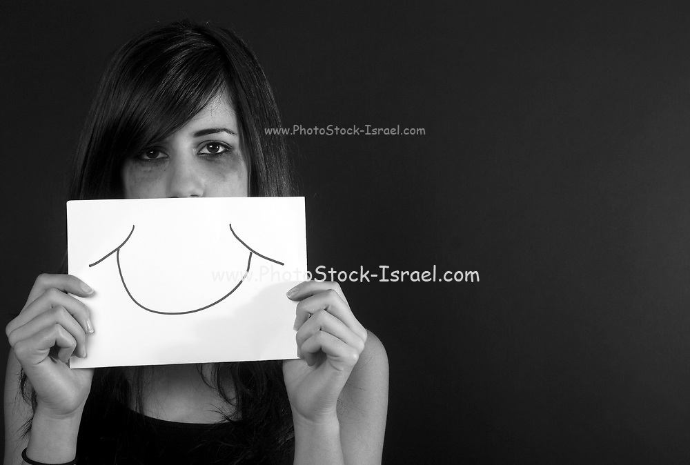 Forced smile female teen with a fake smile on her mouth