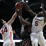 Cedric Kuakumensah, (center), Brown, is blocked by Eric Truog, (left) and Khallid Hart, Marist, during the Marist vs Brown Men's College Basketball game in the Hall of Fame Shootout Tournament at Mohegan Sun Arena, Uncasville, Connecticut, USA. 22nd December 2015. Photo Tim Clayton
