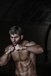hot muscular boxer in a tunnel