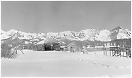 """RGS #461 has entered the Lizard Head snowshed, but only caboose #0401 is visible, although her smoke is pouring through the snowshed roof.<br /> RGS  Lizard Head, CO  Taken by Richardson, Robert W. - 11/17/1951<br /> In book """"Silver San Juan: The Rio Grande Southern"""" page 305<br /> Also in """"Chasing the Narrow Gauge Vol. III"""", p. 122."""