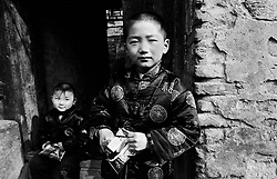 Two boys at Chinese New Year in a hutong in Beijing