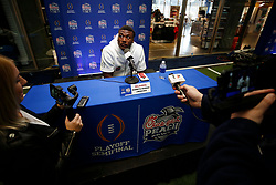 Kenneth Murray #9 of the Oklahoma Sooners speaks with the media at Media Day on Thursday, Dec. 26, in Atlanta. LSU will face Oklahoma in the 2019 College Football Playoff Semifinal at the Chick-fil-A Peach Bowl. (Jason Parkhurst via Abell Images for the Chick-fil-A Peach Bowl)
