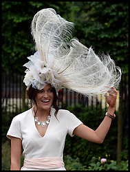 A racegoer attends Ladies Day at Royal Ascot 2013 Ascot, United Kingdom,<br /> Thursday, 20th June 2013<br /> Picture by Andrew Parsons / i-Images