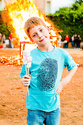 Young boy of 8 at a bonfire with marshmallows