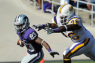 MANHATTAN, KS - SEPTEMBER 26:  Wide reciever Brandon Banks #83 of the Kansas State Wildcats rushes up field during a punt return under pressure form defender Dedrick Miley #96 of the Tennessee Tech Golden Eagles during the fourth quarter at Bill Snyder Family Football Stadium on September 26, 2009 in Manhattan, Kansas.  (Photo by Peter G. Aiken/Getty Images)