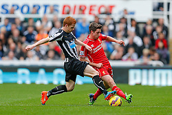 Joe Allen of Liverpool is challenged by Jack Colback of Newcastle United - Photo mandatory by-line: Rogan Thomson/JMP - 07966 386802 -01/11/2014 - SPORT - FOOTBALL - Newcastle, England - St James' Park - Newcastle United v Liverpool - Barclays Premier League.