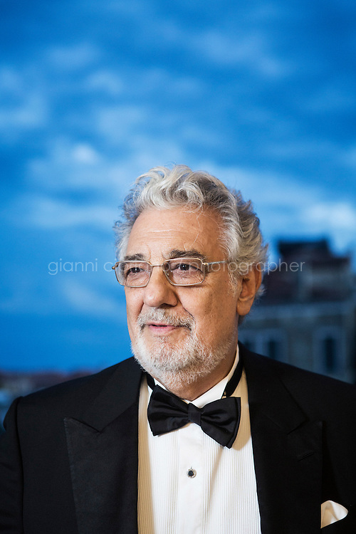 """VENICE, ITALY - 13 JULY 2016: Tenor and conductor Placido Domingo (75) poses for a portrait at the Palazzo Benzon Foscolo before heading to the set of the third season of """"Mozart in the Jungle"""" where will act as himself, in Venice, Italy, on July 13th 2016.<br /> <br /> Mozart in the Jungle is an award-winning television series produced by Picrow for Amazon Studios. The pilot was written by Roman Coppola, Jason Schwartzman, and Alex Timbers and directed by Paul Weitz. The story was inspired by Mozart in the Jungle: Sex, Drugs, and Classical Music, oboist Blair Tindall's 2005 memoir of her professional career in New York."""