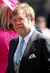Elton John leaves St George's Chapel at Windsor Castle after the wedding of Meghan Markle and Prince Harry.