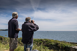 People on Pendennis Point watching sailboats in a race. Falmouth, Cornwall