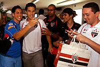 20091124: SAO PAULO, BRAZIL - Sao Paulo players sign autographs at Reebook store in Morumbi Stadium. In picture: Hernanes (2nd L) posing with fans. PHOTO: CITYFILES