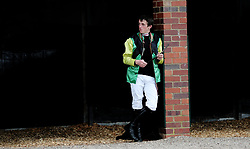 Ben Poste waits for his ride at Worcester Racecourse, Worcester.