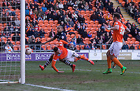 Blackpool's Gary Madine gets in front of Leeds United's Giuseppe Bellusci to score the opening goal<br /> <br /> Photographer Stephen White/CameraSport<br /> <br /> Football - The Football League Sky Bet Championship - Blackpool v Leeds United - Saturday 21st March 2015 - Bloomfield Road - Blackpool<br /> <br /> © CameraSport - 43 Linden Ave. Countesthorpe. Leicester. England. LE8 5PG - Tel: +44 (0) 116 277 4147 - admin@camerasport.com - www.camerasport.com