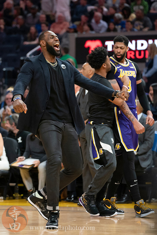 February 27, 2020; San Francisco, California, USA; Los Angeles Lakers forward LeBron James (23), guard Quinn Cook (28), and forward Anthony Davis (3) celebrate during the third quarter against the Golden State Warriors at Chase Center.