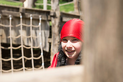 Portrait of a girl smiling in playground, Bavaria, Germany