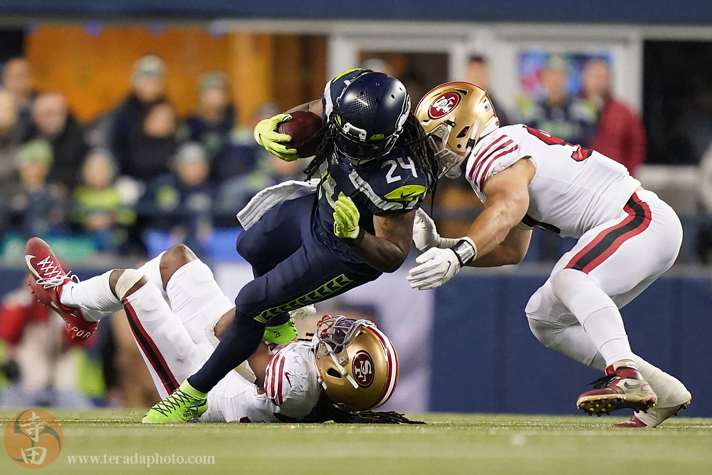 December 29, 2019; Seattle, Washington, USA; Seattle Seahawks running back Marshawn Lynch (24) is tackled by San Francisco 49ers defensive back Marcell Harris (36) and defensive end Nick Bosa (97) during the third quarter at CenturyLink Field.
