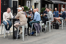 © Licensed to London News Pictures. 04/07/2020. London, UK. Customer drink at outdoor tables after a relaxing of rules during the Covid-19 pandemic. Photo credit: Ray Tang/LNP