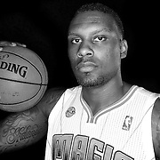 Romero Osby poses in front of a backdrop during the Orlando Magic media day event at the Amway Arena on Monday, September 30, 2103 in Orlando, Florida. (AP Photo/Alex Menendez)