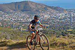 CAPE TOWN, SOUTH AFRICA - MARCH 18: Dutch competitor Wikke Tuinhout ascending Platteklip during the 20km prologue at UCT on Table Mountain on March 18, 2018 in Cape Town, South Africa. Mountain bikers from across South Africa and internationally gather to compete in the 2018 ABSA Cape Epic, racing 8 days and 658km across the Western Cape with an accumulated 13 530m of climbing ascent, often referred to as the 'untamed race' the Cape Epic is said to be the toughest mountain bike event in the world. (Photo by Dino Lloyd)