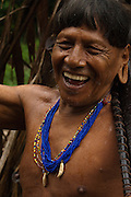 Huaorani Indian, Kempere with his Blowgun.<br /> Bameno Community. Yasuni National Park.<br /> Amazon rainforest, ECUADOR.  South America<br /> This Indian tribe were basically uncontacted until 1956 when missionaries from the Summer Institute of Linguistics made contact with them. However there are still some groups from the tribe that remain uncontacted.  They are known as the Tagaeri & Taromenane. Traditionally these Indians were very hostile and killed many people who tried to enter into their territory. Their territory is in the Yasuni National Park which is now also being exploited for oil.