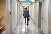 businessman walking through office hallway
