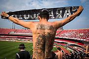 Tattooed Corinthian FC  fan inside the Morumbi statdium, home to Sao Paulo Football club to play the local derby, Sao Paulo city.