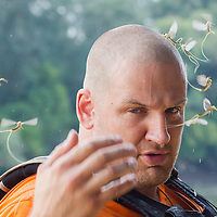 Man is seen with a handful of insects during the yearly few days long swarming of the long-tailed mayfly (Palingenia longicauda) on the river Tisza in Tiszainoka (some 135 km south-east from Budapest), Hungary on June 23, 2013. ATTILA VOLGYI<br /> The long-tailed mayfly larves live 3 years under water level in the river banks then swarm out for a one day period of their life to die after mating.