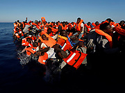 Migrants fall off their rubber dinghy during a rescue operation by the Malta-based NGO Migrant Offshore Aid Station (MOAS) ship in the central Mediterranean in international waters some 15 nautical miles off the coast of Zawiya in Libya, April 14, 2017. All 134 sub-Saharan migrants survived and were rescued by MOAS.  REUTERS/Darrin Zammit Lupi