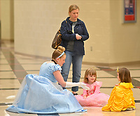 Megan Zaves, a senior at Ravenwood portraying Cinderella, talks with Eleanor Brown and Maris Benkert during the Ravenwood Royal Experience at Ravenwood High School Saturday, March 30, 2019. During the event children met Disney Princesses and enjoyed a sing along with them. The event is a fundraiser for St Jude Children's Hospital and the Ravenwood Theatre Department. Photo Harrison McClary/News & Observer