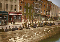 Republican prisoners on Bachelors Walk being marched to detention after the Rising. (Part of the Independent Newspapers Ireland/NLI Collection) Colourised by Tom Marshall (PhotograFix).