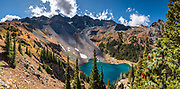 Dallas Peak rises above Lower Blue Lake, in Mt Sneffels Wilderness, Uncompahgre National Forest, San Juan Mountains, near Ridgway, Colorado, USA. This image was stitched from multiple overlapping photos.
