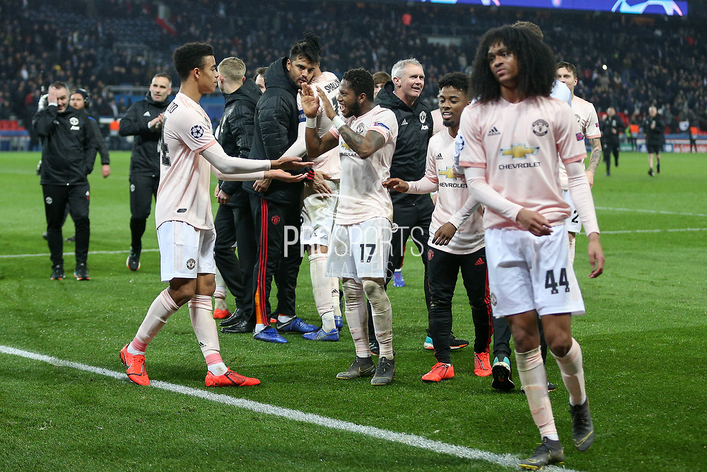 Manchester United forward Mason Greenwood celebrates with Manchester United Midfielder Fred during the Champions League Round of 16 2nd leg match between Paris Saint-Germain and Manchester United at Parc des Princes, Paris, France on 6 March 2019.